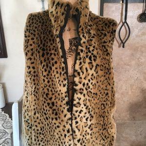 Leopard print reversible vest.